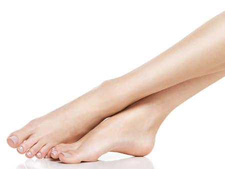 Beautiful women feet isolated on white. Close-up. Standard-Bild - 129140015