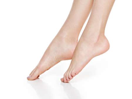 Beautiful women feet isolated on white. Close-up. Standard-Bild - 129140487