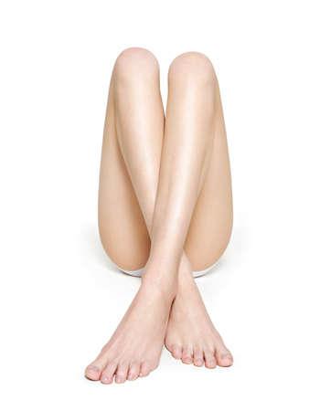 Beautiful woman legs isolated on white background Standard-Bild - 129140756