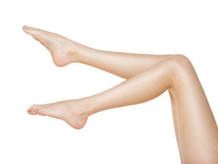 Beautiful female legs after depilation isolated on white Standard-Bild - 129140903