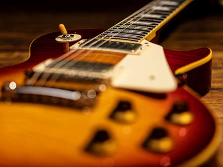 electric guitar body close-up view is on the wood floor Banque d'images - 129141348
