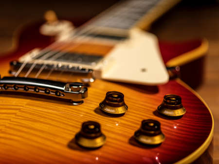 electric guitar body close-up view is on the wood floor Banque d'images - 129141641