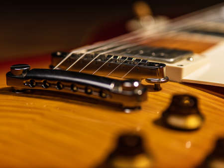 electric guitar body close-up view is on the wood floor Banque d'images - 129141669