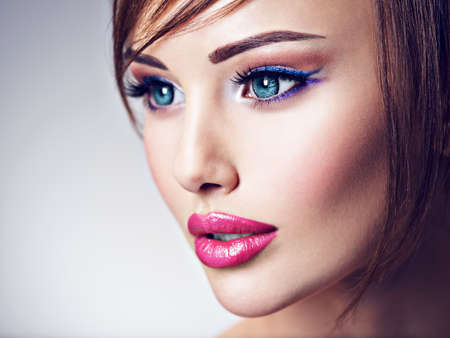 Attractive caucasian woman with beautiful big blue eyes. Closeup face of an amazing girl with sexy lips. Profile portrait.