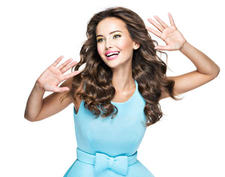 Happy Fashionable Woman with expressive emotions. Beautiful fashion model in blue dress over white background