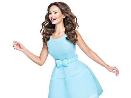Beautifulhappy woman in blue dress long hair brown. Happy Fashionable Woman with expressive emotions. Фото со стока