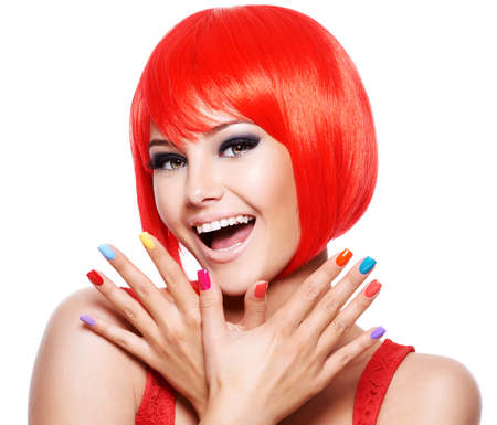 Close-up face of a fun expressive girl with bright multicolor nails. Fashion model posing on white background Imagens