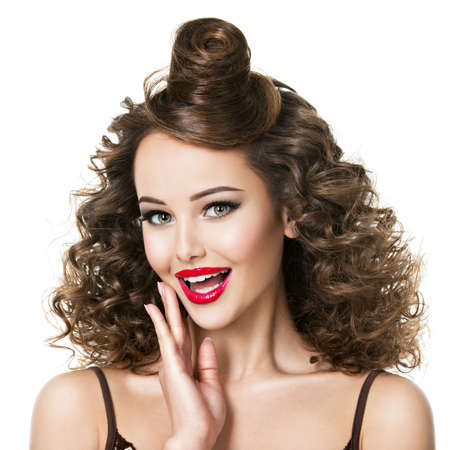 Attractive emotional adult girl with expressive emotions. Beautiful woman with creative fashion hairstyle.