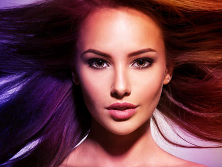 Beautiful woman with long brown hair. Tinted photo