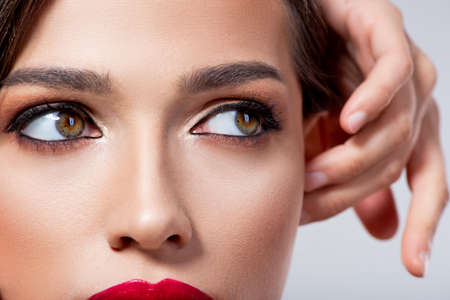Photo of closeup of stunning woman's eyes.  Beautiful Eyes of young girl looking to the camera. Macro image of the girl's eyes with long eyelashes. Female hazel eyes. Model with classic eye makeup.