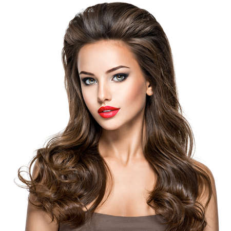 Beautiful woman with long brown hair. Fashion model over white background. Stockfoto