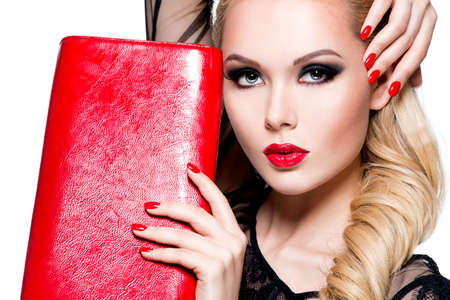 Portrait of beautiful young woman with bright red lips and nails. Concept - glamour fashion makeup Reklamní fotografie