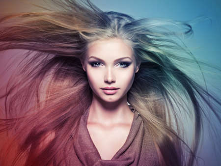Face of the Beautiful young woman with long straight hair. Closeup portrait of a attractive girl over creative colored background