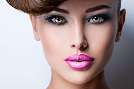 Closeup face of beautiful woman with fashion bright vivid color makeup 写真素材