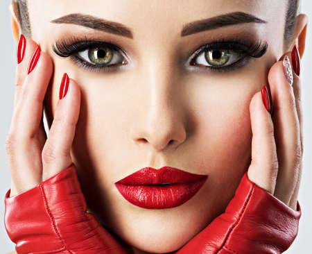 beautiful woman with bright fashion make-up and red lipstick on sexy lips. Closeup portrait.