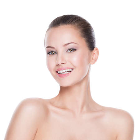 Beautiful face of young smiling woman with clean fresh skin - isolated on white Reklamní fotografie