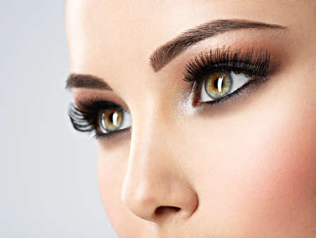 Beautiful  woman's eyes with brown eye makeup. Macro  image. Closeup face of a pretty girl Banque d'images