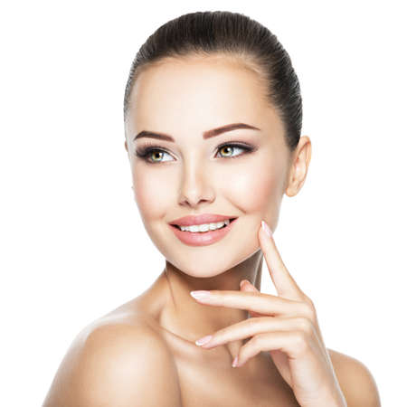 Beautiful face of young smiling woman with health fresh skin