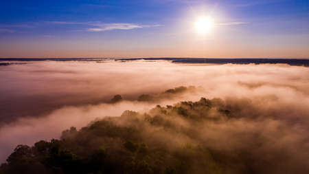 Aerial  view of a beautiful summer  landscape with a fog while dawn.  Photo from drone of a foggy landscape in spring. Top view to land while sunrise. Sun is above the horizon Reklamní fotografie