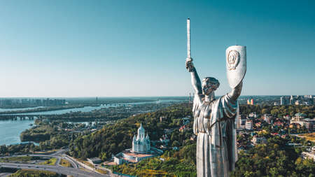 Aerial view to the  Beautiful landscape city Kiev with a Dnepr river. Top view to the Motherland statue in the Kiev. The well-known landmarks in Kyiv. Historical monument of Soviet union. Reklamní fotografie