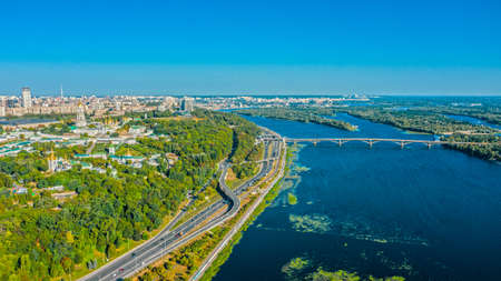 Aerial view to the  Beautiful cityscape city Kiev with a Dnepr river in sunny day. Top view to the urban landscape. Panorama of a big european city. Reklamní fotografie