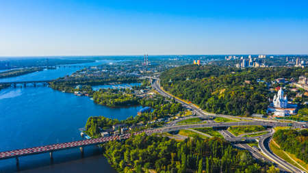 Aerial view to the  Beautiful landscape city Kiev with a Dnepr river in sunny day. Top view to the urban landscape. Panorama of a big european city. Reklamní fotografie