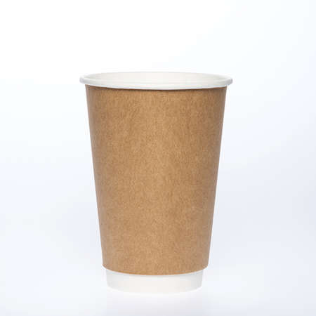 Photo of a disposable brown paper cup on a white background. Photo of a coffee cup made of recyclable materials. Empty paper coffee cup. Reklamní fotografie