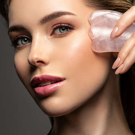 Beautiful face of young caucasian woman with perfect healthy skin, isolated. Pretty white model caring of face. Beauty treatment concept. Skin care concept. Reklamní fotografie