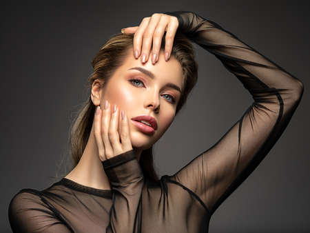 Beautiful face of young  woman with healthy skin. Pretty model caring of face.  Skin care concept.