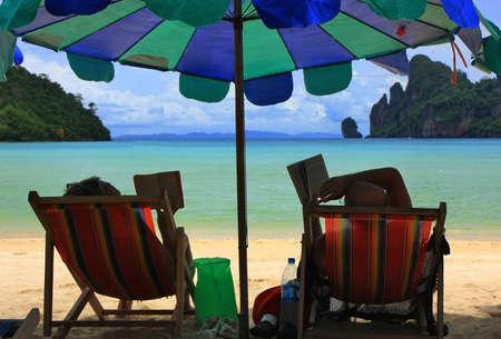 Reading on the beach, Thailand photo