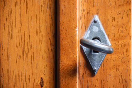 Wooden door with vintage focus at key and blur keyhole