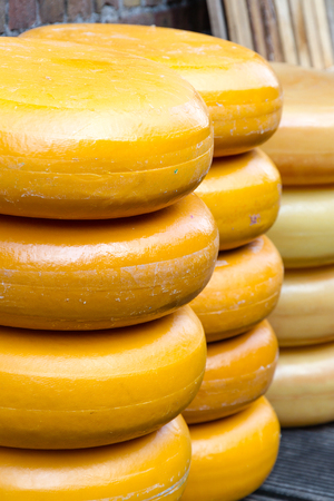 Pile of Gouda cheese offloaded on a quay in Gouda harbor on the occasion of the annual Harbor Days, The Netherlands