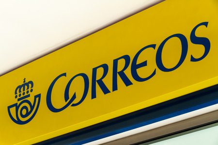 MARBELLA, SPAIN - FEBRUARY 26, 2018: Correos (post) sign at the main post office.