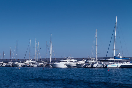 MARBELLA, SPAIN - FEBRUARY 11, 2018: White luxury yachts in the harbour of mundane Marbella, Costa del Sol.
