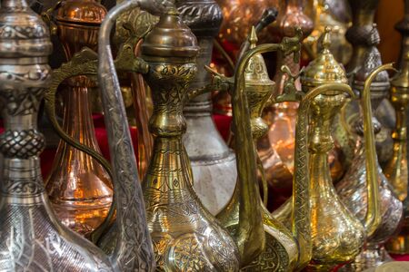 Decorative old style metal pitchers for sale; Istanbul, Turkey.