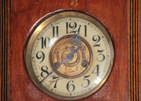 Ancient wooden clock photo