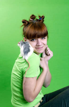 Portrait of the young girl  with white rat photo