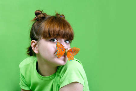 Young girl  with  butterfly photo