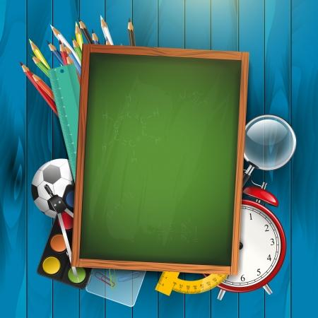 School supplies and empty green chalkboard
