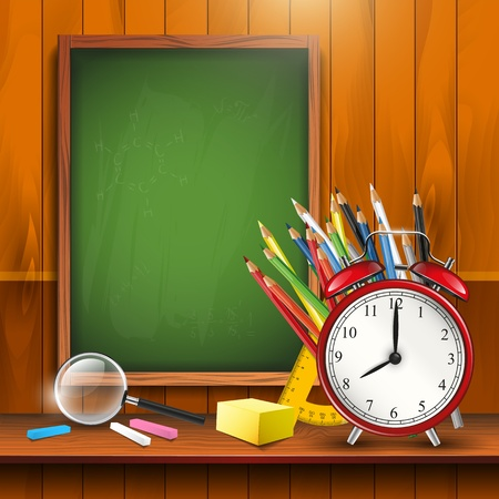 School supplies and empty blackboard with copyspace