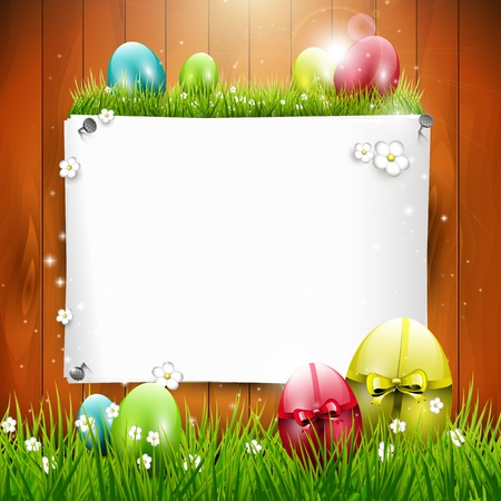 easter decorations: Easter greeting card with colorful eggs and empty paper on wooden background