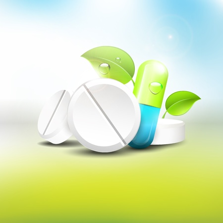 Pillen en tabletten met bladeren op een blauwe achtergrond - gezondheid concept