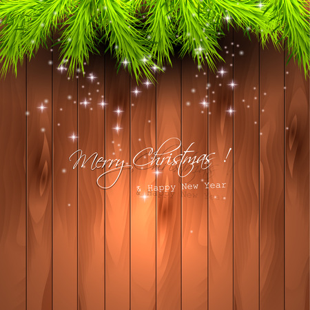 Christmas greeting card with branches on wooden background