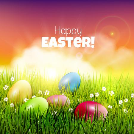 Huevos de Pascua en la hierba al atardecer