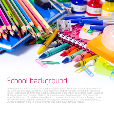 Colorful school supplies background with copyspace photo