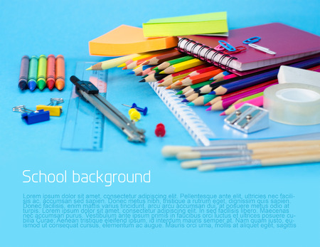 School supplies on blue background