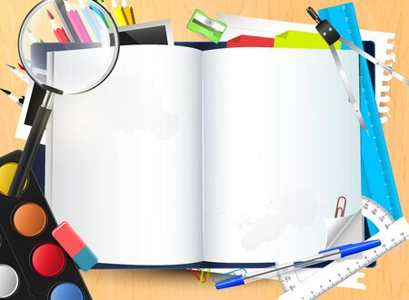utiles escolares: Abra la libreta con el lugar para su texto y útiles escolares en el escritorio de la escuela