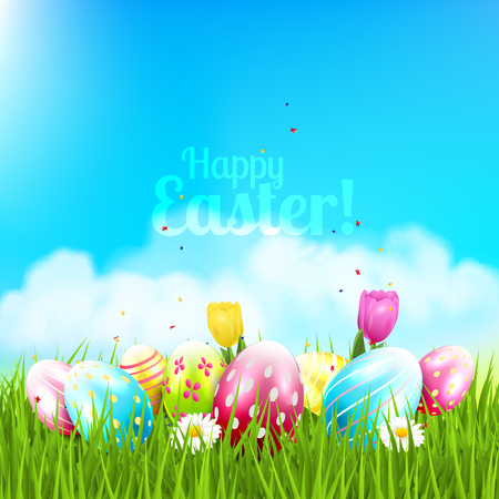 tulips in green grass: Easter greeting card with colorful eggs and flowers in the grass