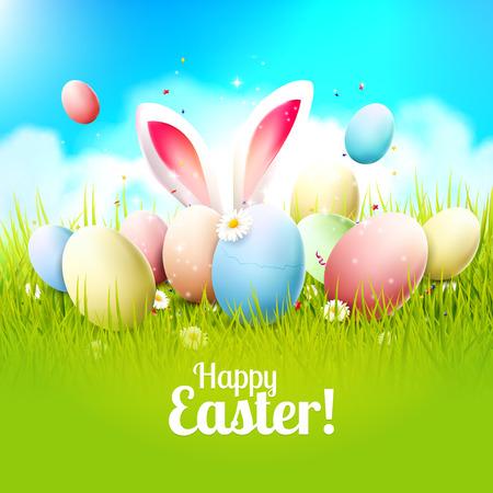 oido: tarjeta de felicitación de Pascua con huevos de colores y orejas de conejo en la hierba