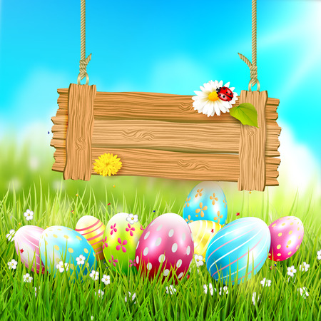 festive: Easter greeting card - Easter eggs in the grass and wooden sign